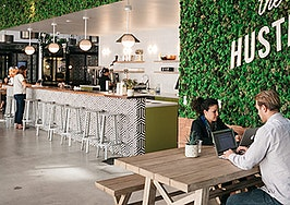 WeWork buys biz that converts stores into coworking spaces