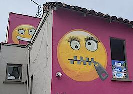 Pink emoji house that caused neighborhood furor up for sale