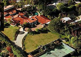 John Travolta sells Los Angeles estate to record exec Scooter Braun
