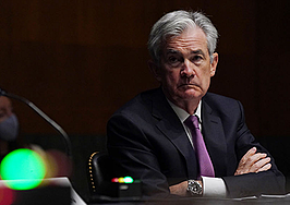 Fed says it wants to see job numbers before tapering