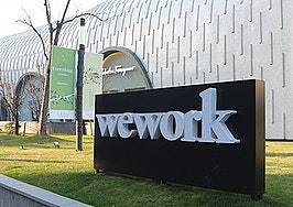 WeWork finally goes public, stock jumps on 1st day of trading